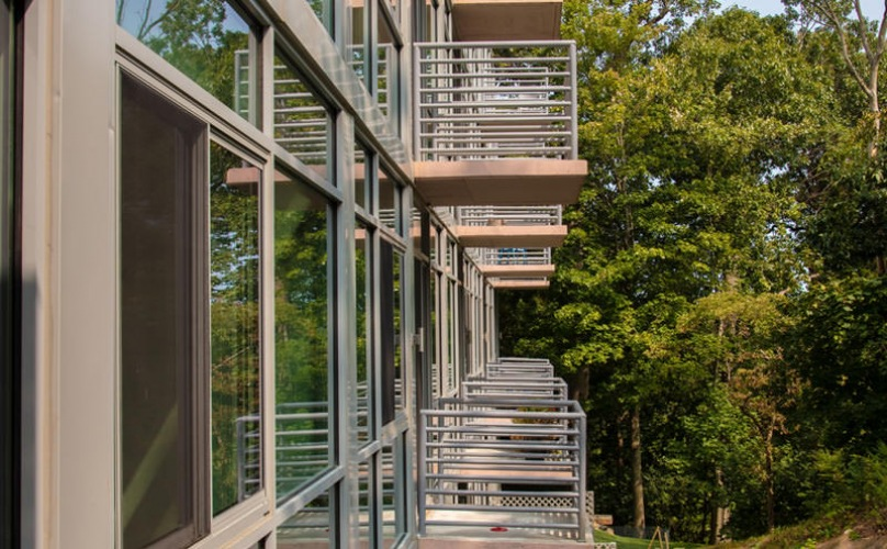 private balconies overlook wooded areas surrounding Glasshouse 250